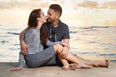 Beautiful couple on the beach. Summer, love. Attractive couple on the beach Royalty Free Stock Photography