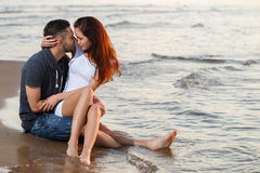Beautiful couple on the beach. Summer, love. Attractive couple on the beach Stock Images