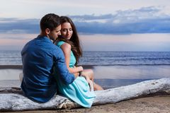 Beautiful couple on the beach. Summer, sea. Cute, lovely couple on the beach Stock Image