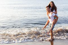 Beautiful couple on the beach Royalty Free Stock Photo