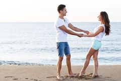 Beautiful couple on the beach. Summer, sea. Cute, lovely couple on the beach Royalty Free Stock Photography