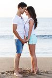 Beautiful couple on the beach. Summer, sea. Cute, lovely couple on the beach Stock Photos