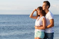 Beautiful couple on the beach. Summer, sea. Cute, lovely couple on the beach Stock Photo