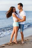 Beautiful couple on the beach. Summer, sea. Cute, lovely couple on the beach Royalty Free Stock Images
