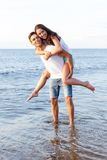 Beautiful couple on the beach. Summer, sea. Cute, lovely couple on the beach Stock Photography
