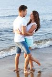 Beautiful couple on the beach. Summer, sea. Cute, lovely couple on the beach Royalty Free Stock Photos