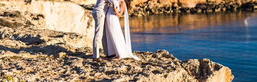 Beautiful couple on the beach. In wedding dress Royalty Free Stock Image