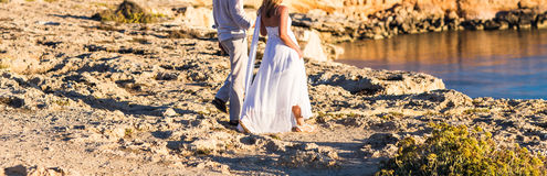 Beautiful couple on the beach. In wedding dress Stock Images