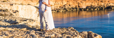 Beautiful couple on the beach. In wedding dress Royalty Free Stock Photos