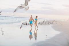 Beautiful couple on the beach Stock Photography
