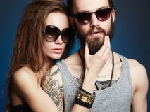 Beautiful couple. bearded Hipster boy and girl. Fashion beautiful couple in sunglasses. bearded Hipster boy and beauty girl with tattoo Stock Photos