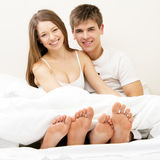 Beautiful couple in bed Royalty Free Stock Image