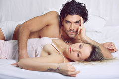 Beautiful couple in bed Royalty Free Stock Photo