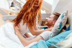 Beautiful couple romance in bed. Beautiful couple being romantic and passionate in bed royalty free stock image
