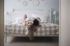 Beautiful couple being romantic and passionate in bed. Beautiful young couple being romantic and passionate in bed Royalty Free Stock Photos