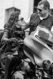 Beautiful couple of bikers in leather clothes on a motorcycle stock images