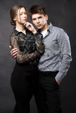 Beautiful couple on black background Stock Images