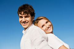 Beautiful couple on blue sky Royalty Free Stock Photography