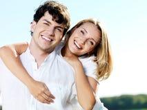 Beautiful couple on blue sky stock image