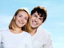 Beautiful couple on blue sky Royalty Free Stock Photos