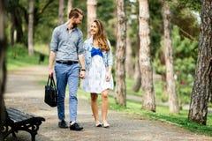 Beautiful couple bonding in park stock photos