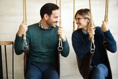 Beautiful couple bonding while in swing. Beautiful couple in love bonding while sitting in swing Stock Photos