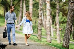 Beautiful couple bonding in park stock photography