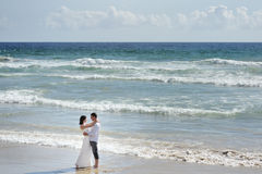 Beautiful couple bride and groom on the beach of Sperlonga, Italy Stock Image