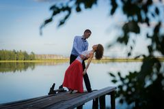 Beautiful couple on bridge on Lake Stock Image