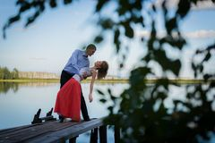 Beautiful couple on bridge on Lake Stock Images