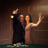 Beautiful couple celebrating victory in poker game Stock Photo