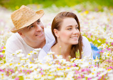 Beautiful couple on chamomile meadow Royalty Free Stock Photography