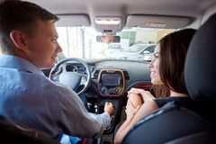 View of a Young business man couple in their brand new car Royalty Free Stock Photo
