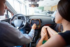 View of a Young business man couple in their brand new car Royalty Free Stock Photos