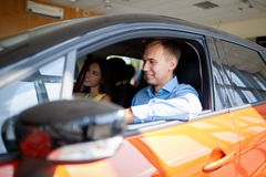 View of a Young business man couple in their brand new car Stock Images