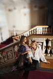 Beautiful couple in the clothing of the 18th century. In a luxurious interior Stock Photos
