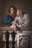 Beautiful couple in the clothing of the 18th century. In a luxurious interior Stock Image