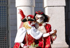 Beautiful couple in colorful costumes and masks, Santa Maria della Salute Stock Photography