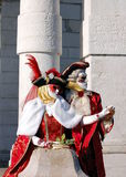 Beautiful couple in colorful costumes and masks, Santa Maria della Salute Stock Images