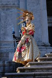 Beautiful couple in colorful costumes and masks, Santa Maria della Salute Royalty Free Stock Image