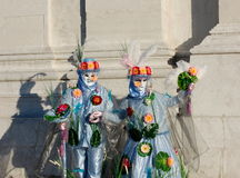 Beautiful couple in colorful costumes and masks, Venetian Carnival Royalty Free Stock Photo