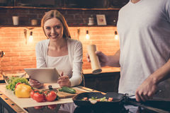 Beautiful couple cooking royalty free stock image