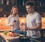 Beautiful couple cooking stock photography