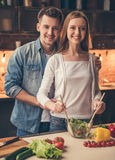 Beautiful couple cooking royalty free stock images