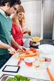 Beautiful couple cooking together Royalty Free Stock Images