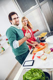 Beautiful couple cooking together Stock Images