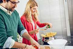 Beautiful couple cooking together Royalty Free Stock Photo