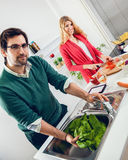 Beautiful couple cooking together Royalty Free Stock Photos