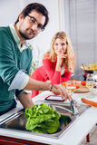 Beautiful couple cooking together Stock Image