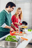 Beautiful couple cooking together Stock Photos